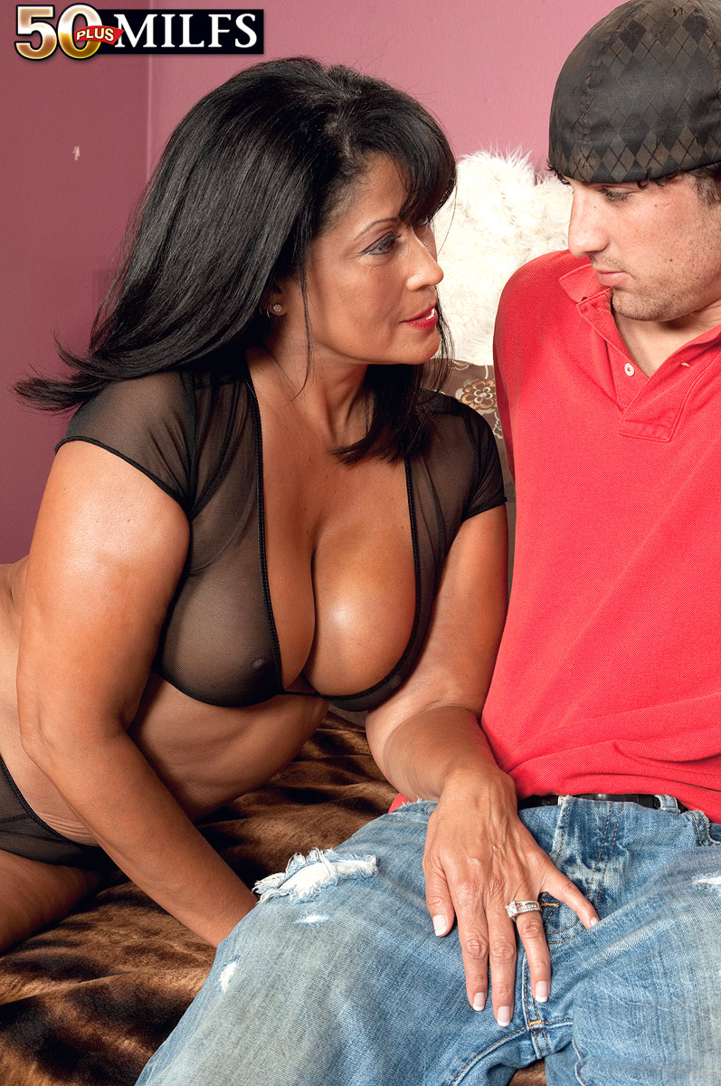 sexy 50 plus brunette shows off her naughty parts to young stud and
