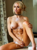 Amazing fair-haired babe Alix Lynx flaunts her perfect boobs and bald pussy