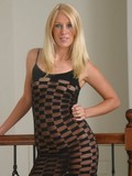 Sassy goldilocks has nothing but black tight dress on and she strips it too