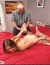 Big titted amateur lady gets undressed and spanked before hogtie bondage on the bed