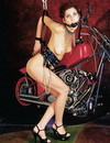 Sweetie getting gagged and tied up to the bike