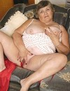 Aged woman in red panties spreads her legs and shows her cunt with no shame