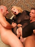 Heavy titted blonde in black crotchless body stocking gets fucked by two men