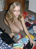 Nude tight girl Ashley sorts her clothes on the floor in the middle of her room