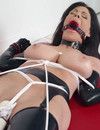 Heavy titted brunette in latex stockings and high heels gets ball gagged and tied up