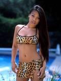 Asian beauty taking sun bath in bikini and mother-naked