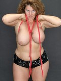 Chubby mature strips black latex teddy and ropes her huge boobs and then fingers