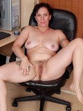 Fat tattooed mature strips her dress and panty to play with her shaggy wide beav