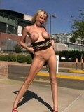 Hot bodied tall blonde Kylie Worthy flashes her shaved mouth and big melons in t