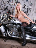 Leggy biker girl in black stockings  shows off her sexy juicy natural boobs