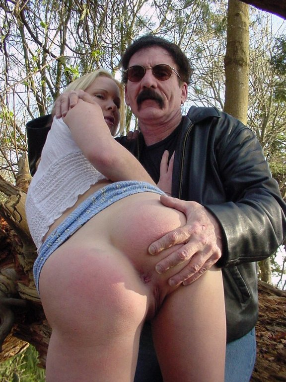 Tight blonde chick in blue mini skirt gets her sexy tiny bare ass spanked  in the forest