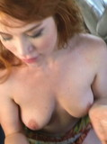 Bad girl in short dress takes off her thong and gives suck job in a car