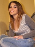 Attractive babe in blue jeans shows off her amazing feet on the stairs