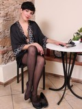 Short haired brunette lady shows off her legs and feet with her shoes on