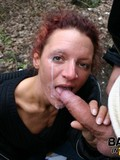 Red haired slut gets fucked from behind just in the park and has her face covered in cum