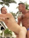 Gay guy deepthroats tattooed daddy's cock by the pool and gets fucked in the ass outside