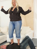 Fat blonde touches guy's face with her shoes when trampling him on the floor at