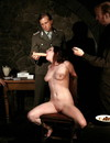 Fully nude submissive girl with shaved snatch and natural tits gags on dildo with obedience