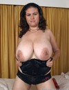 Shameless brunette demonstrates her heavy natural breasts before she gets her snatch out