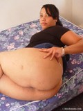 Plump ebony mommy with heavy breasts strips down to her white thong panties