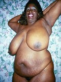 Chocolate skinned mature plumper with giant heavy tits strips down to her bare skin