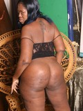 Chocolate skinned BBW lady exposes her big ass and opens her legs to show her pussy