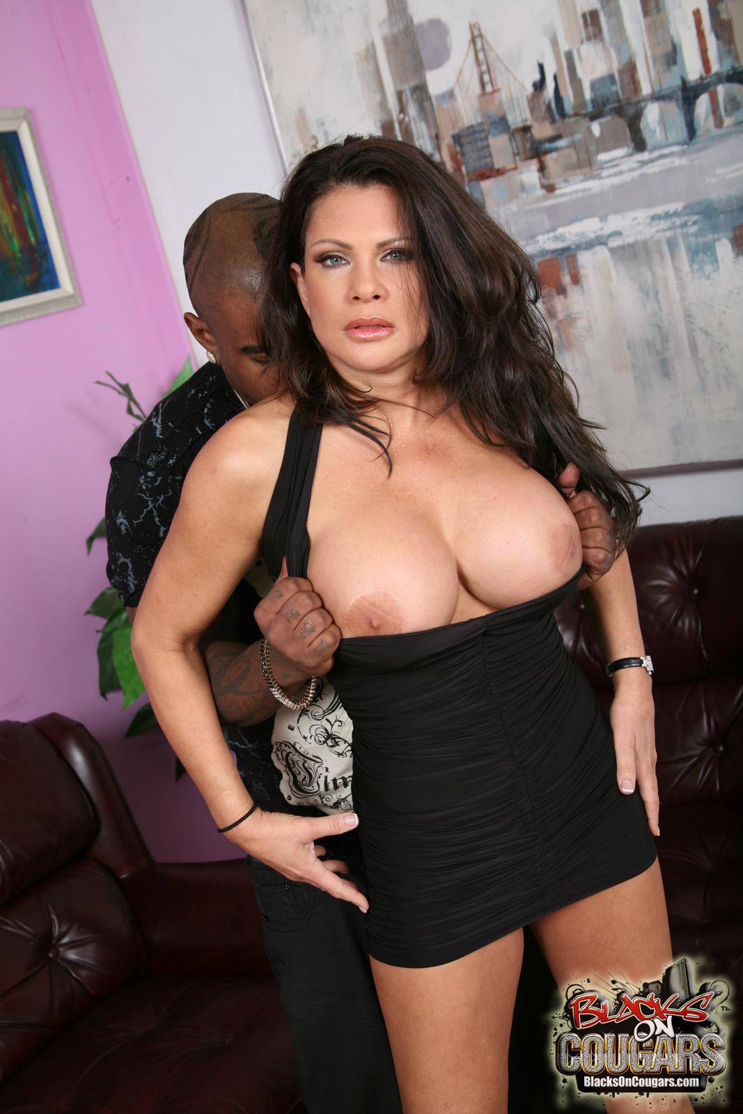 charming long haired brunette milf in sexy black dress enjoys meaty