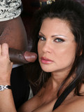 Charming long haired brunette milf in sexy black dress enjoys meaty chocolate cock