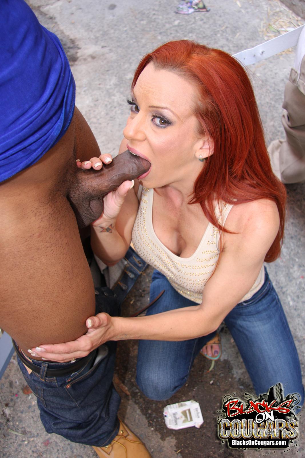Redhead milf sucking fucking black cock