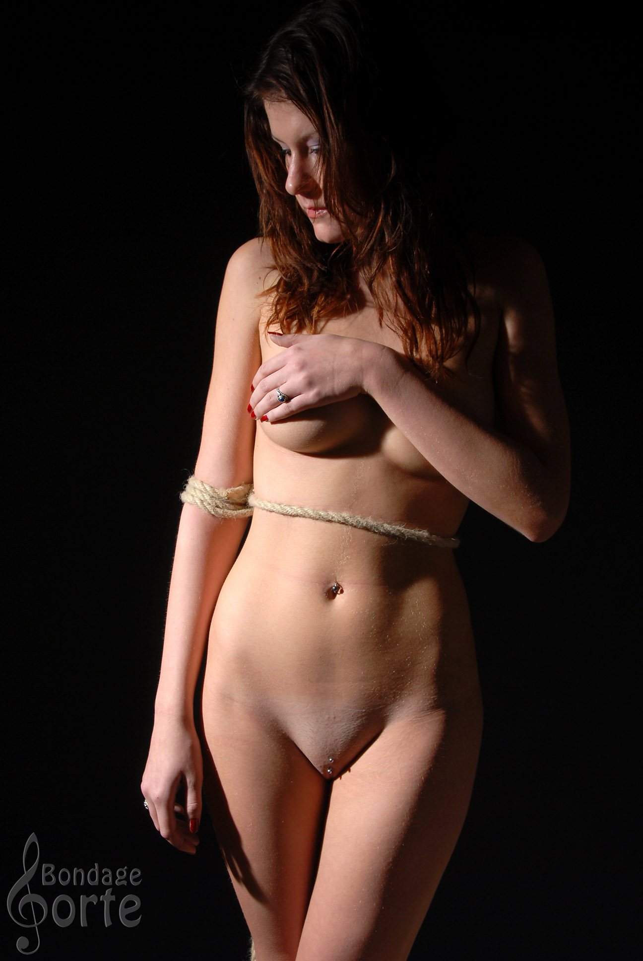 Nude tied up girl poses in semi-dark and in the daylight ...