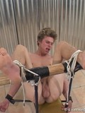 Blond guy gets squeezed by ropes and then his feet painfully flogged and strapped