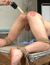 Tied gay slave gets his  ass dildo fucked deep and spanked by unmerciful master