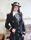British police girl in uniform poses and strips showing her long legs in black p