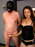 Masked slave man gets his fat dick teased and tortured by very curious brunette mistress