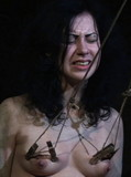 Shocking tit torture session for shaved pussy brunette girl in the dungeon