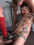 Inked up gay victim licks asses and cocks of two brutal men before getting his b