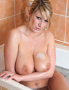 Attractive blonde babe with adorably huge natural tits takes a bath for your enjoyment