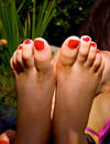 These girls go crazy about displaying their soles and neat feet in the sun