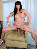 Sexy assed black haired shemale takes off her pink panties and poses naked