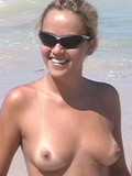 Shameless camera shoots blonde Brazilian tanning topless and her round ass in th