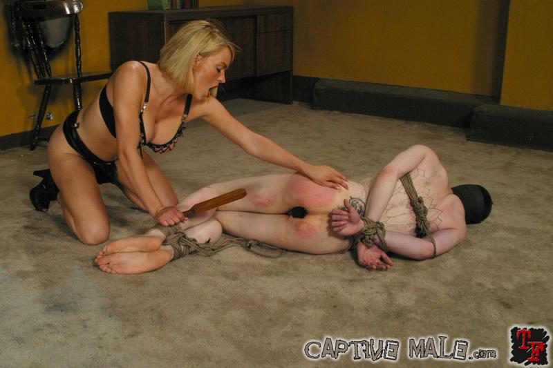 Torturing my slaves feet with a mace ball