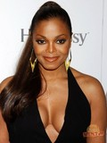 Sexy chocolate celebrity Janet Jackson appears in revealing dress in public and poses in bikini