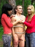 Two dressed chippies make guy undress and stay in doggy in female domination scenes