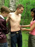 Two slutty chicks have fun with their thin slave in the forest painting on him b