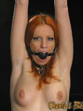 Nude redhead slave girl opens her legs for mistress and gets anally used