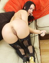 Sexy assed brunette in black lingerie shows her private parts with big enthusiasm