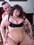 Curly haired chunky lady with massive tits has great sex in the middle of a bed