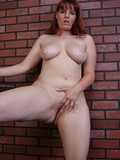 Chubby redhead with beautiful eyes gets nude to show her smooth puffy pussy and juicy jugs