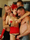 Tattooed burlesque lady in red Vanessa Sky gets shared by three men in the bathroom