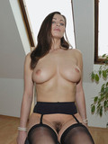 Helpless perfect boobed brunette Kyla Cole in stockings is helpless on a chair
